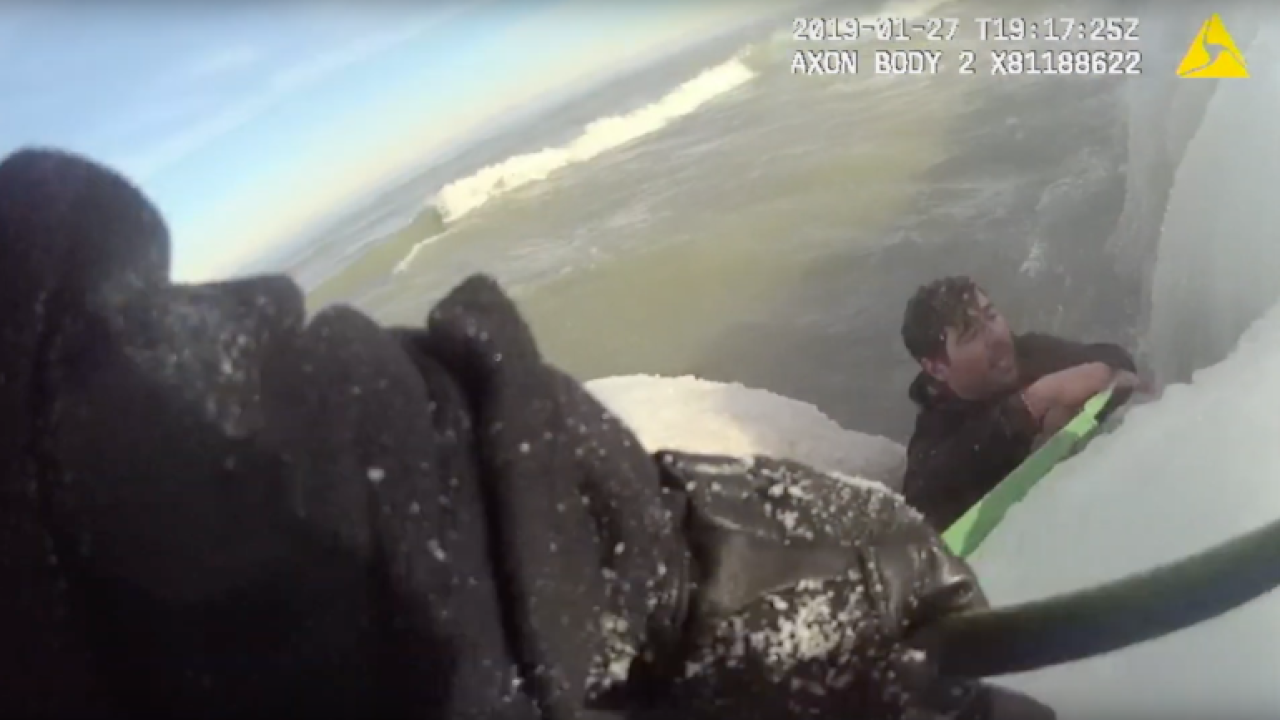 Body camera footage shows Chicago police rescuing man from an icy Lake Michigan