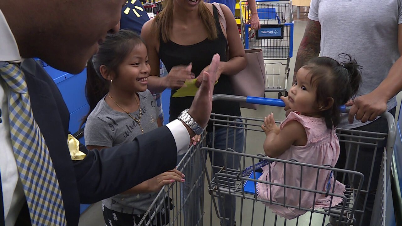 Rob Desir helps Richmond families with their back-to-schoolshopping