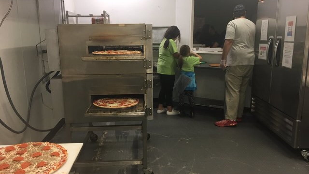 North Tulsa youth group is growing as it uses pizza to feed the hungry across the community
