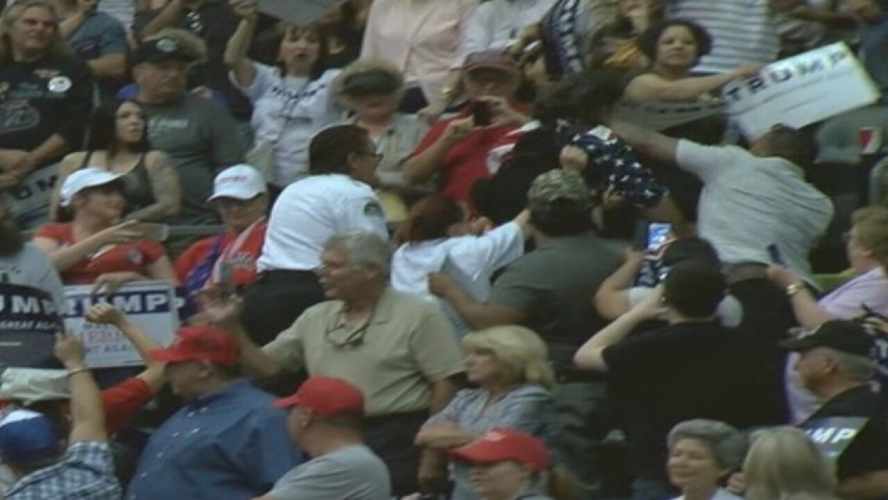 Protester punched, kicked at Trump Tucson rally
