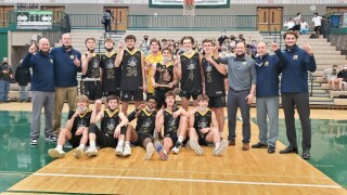 Grand Haven boys basketball wins district title