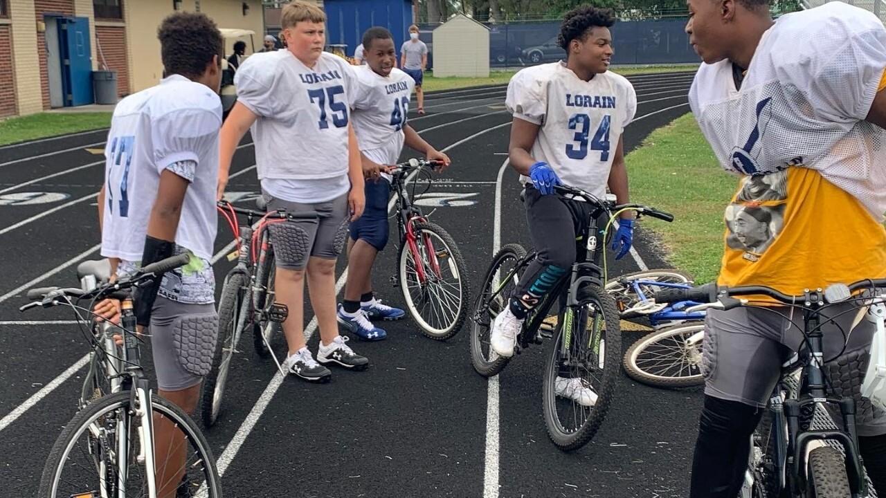 Lorain police donate bikes to football players walking miles
