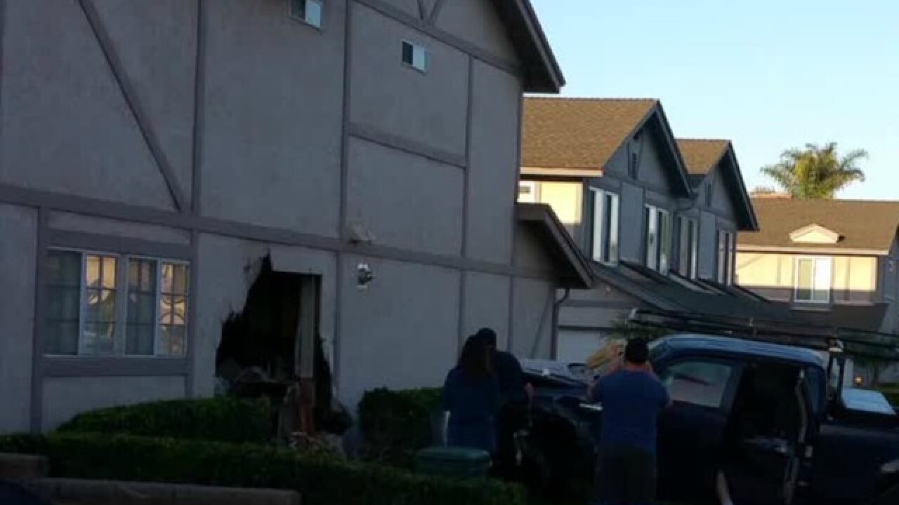 Driver crashes truck into Carlsbad townhouse