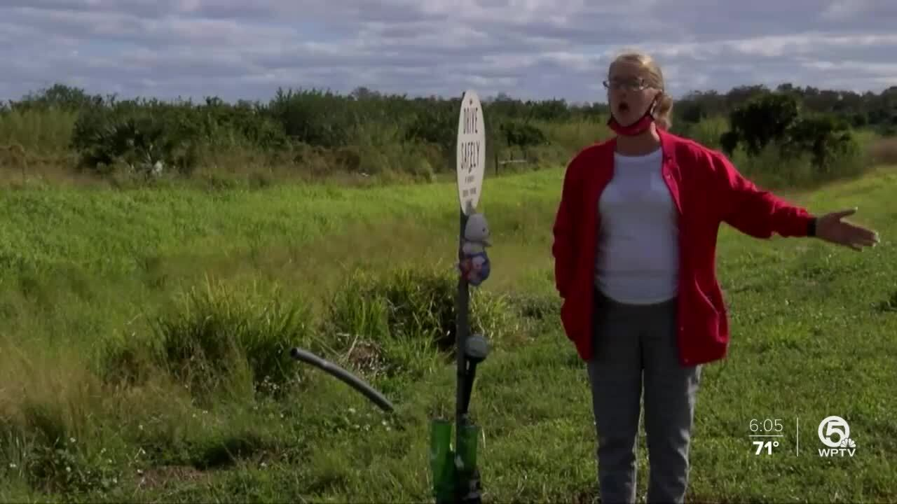 """Dorothy Reynolds stands by roadside marker for Robert """"Chino"""" Perone"""
