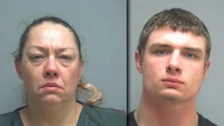Emma Robberts mother and brother.jpg