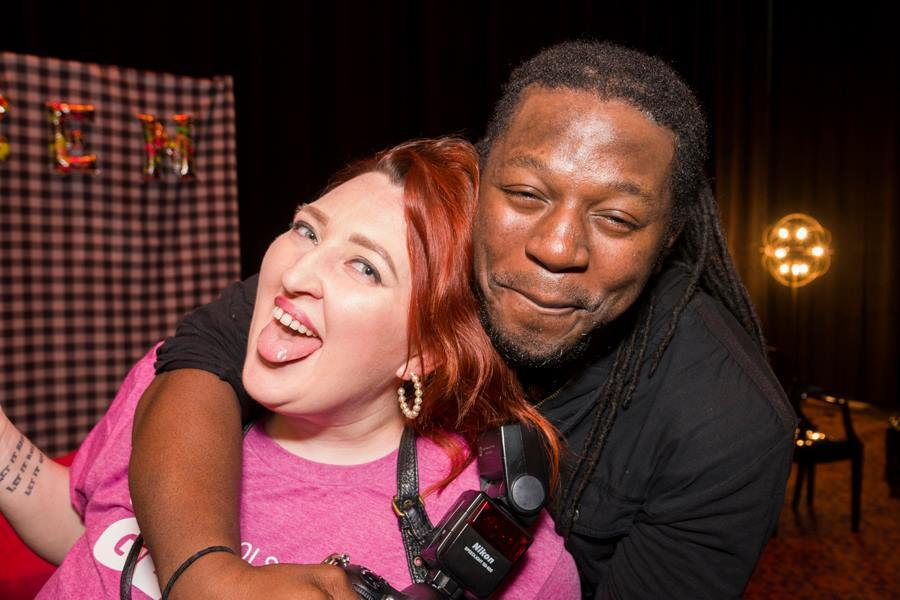 This candid photo shows two smiling people at a GLSEN Greater Cincinnati adult prom fundraiser.