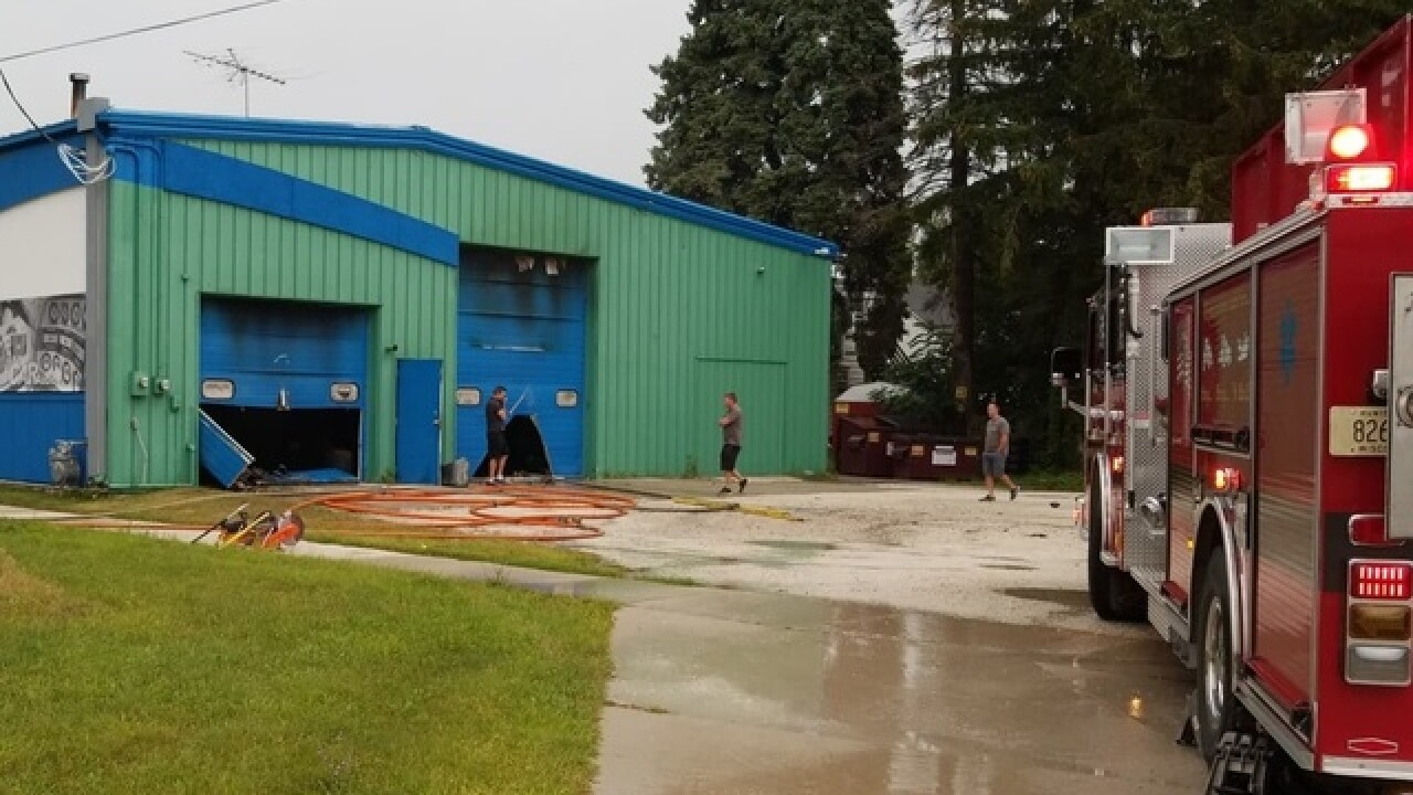 Crews battle fire at Extreme Audio in Manitowoc