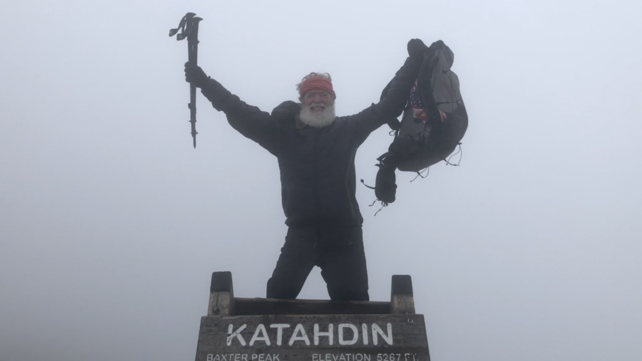 Kevin Newsome, 66, at the top of Mt. Katahdin after thru-hiking the Appalachian Trail.