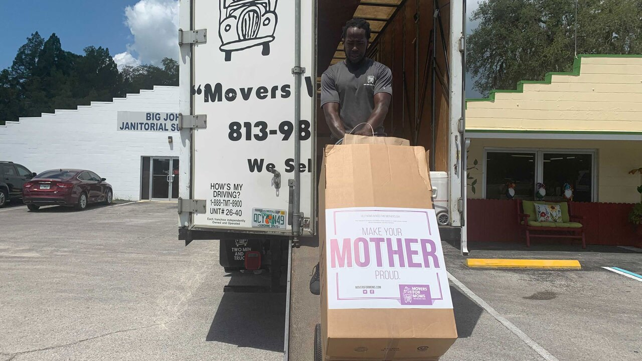 Two-Men-and-a-Truck-delivering-gifts-to-moms-in-shelters-WFTS.jpg