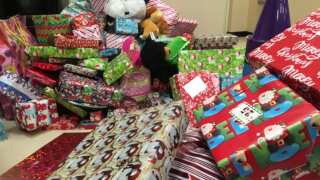 Children living in public housing receive toys ahead of Christmas