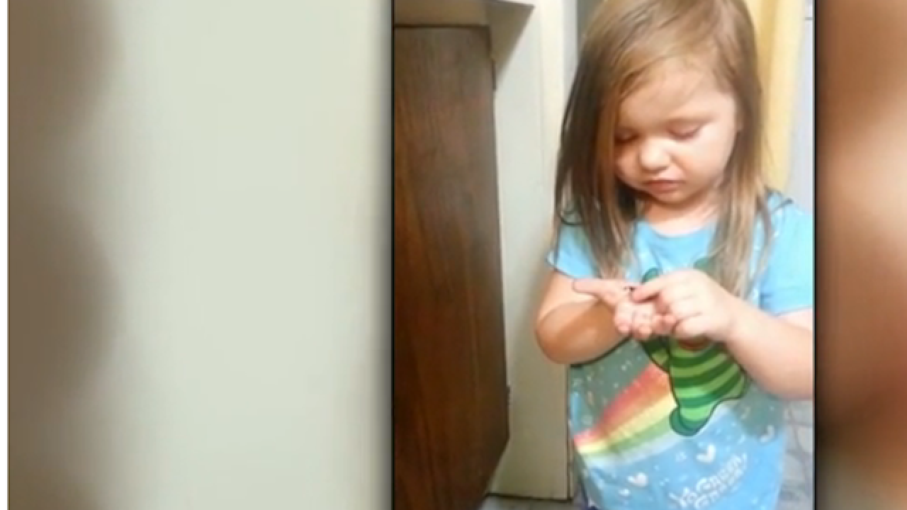 Confused toddler tastes dark chocolate for the first time