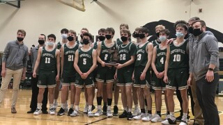 Coopersville boys basketball wins district title