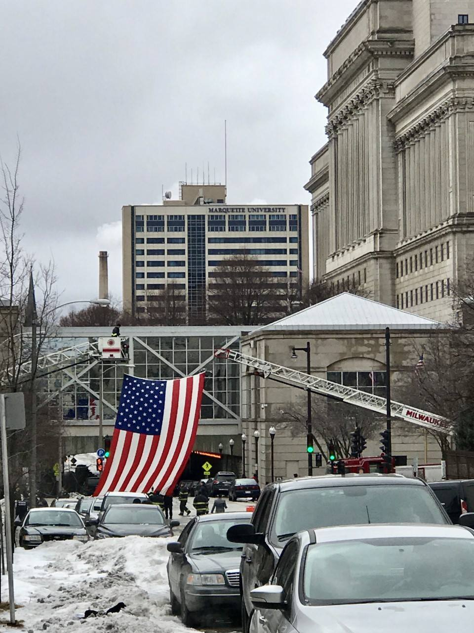 A giant American Flag was unfurled at 9th and State in downtown Milwaukee.