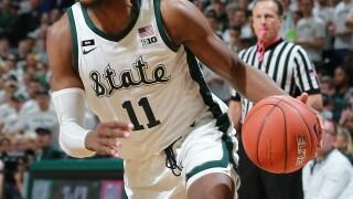 MSU's Tillman stays in NBA Draft, Henry to return