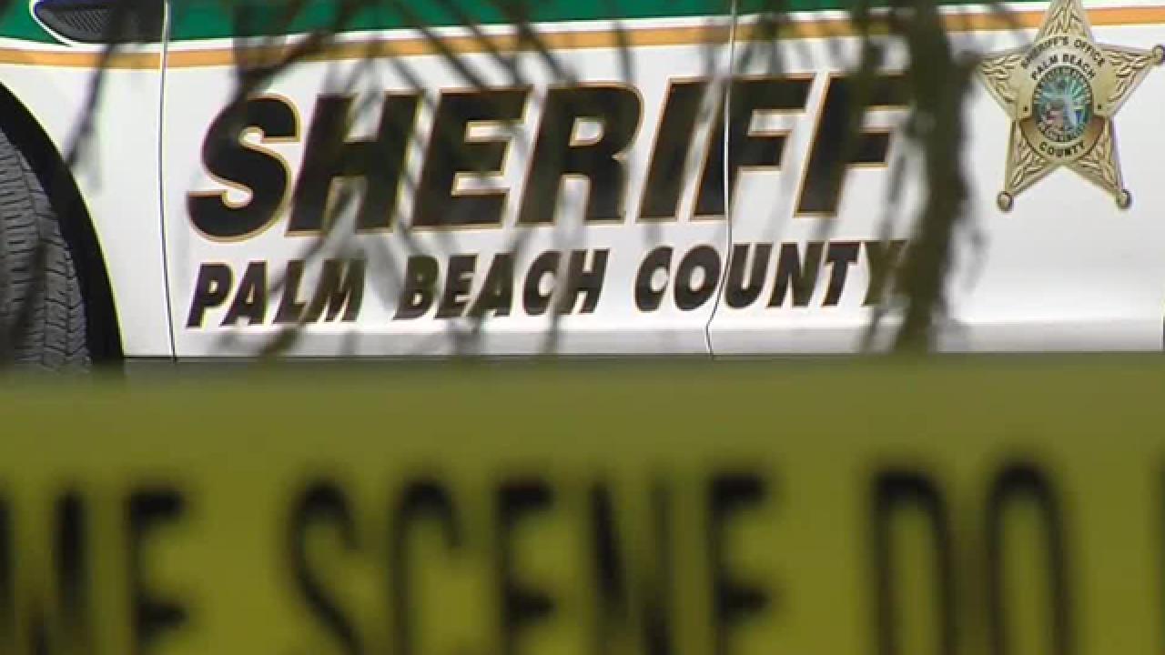 WPTV PBSO crime scene tape WPTV Palm Beach County Sheriff's Office crime scene