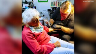 103-year-old celebrates birthday and end of isolation with tattoo