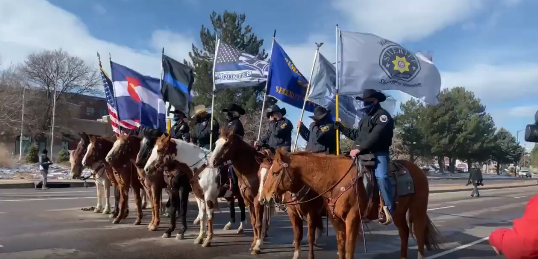 Eric Talley procession March 30 2021_horses and flags