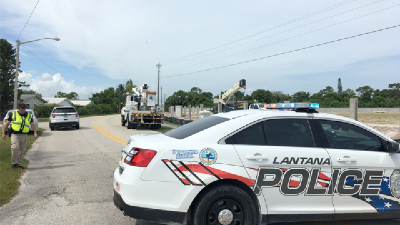 2 shocked after crane hits power line