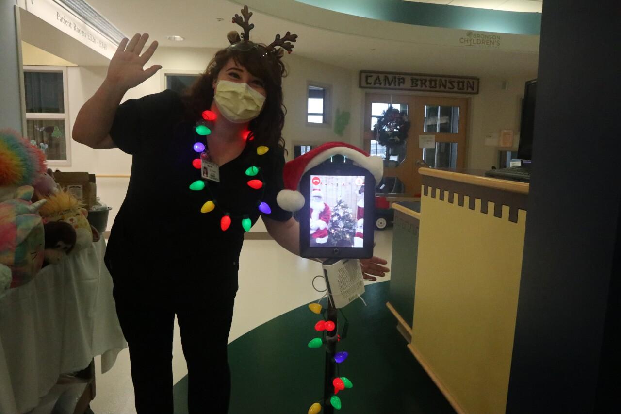 Reindeer helping guide Santa through Bronson Children's Hospital