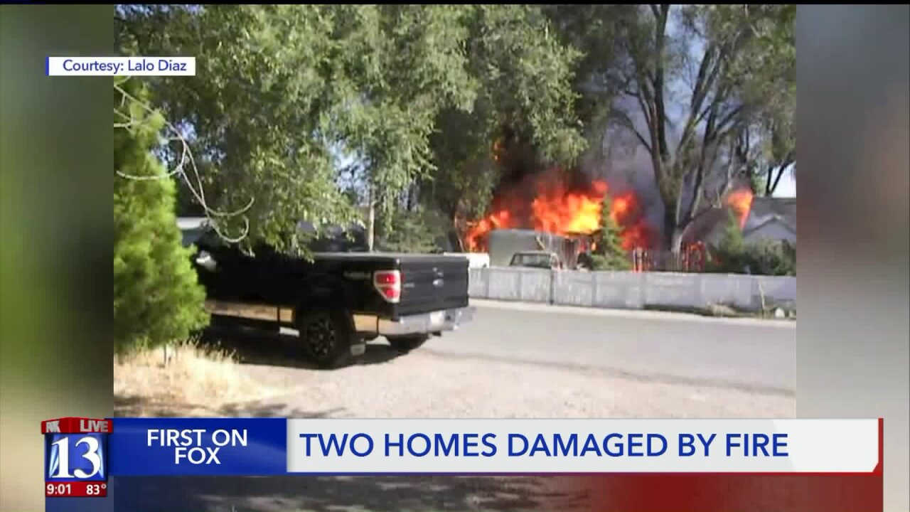 Firefighters respond to 2 alarm fire that burns 2 homes in West Valley City