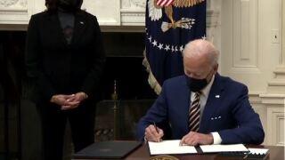 Biden signing exec orders.JPG