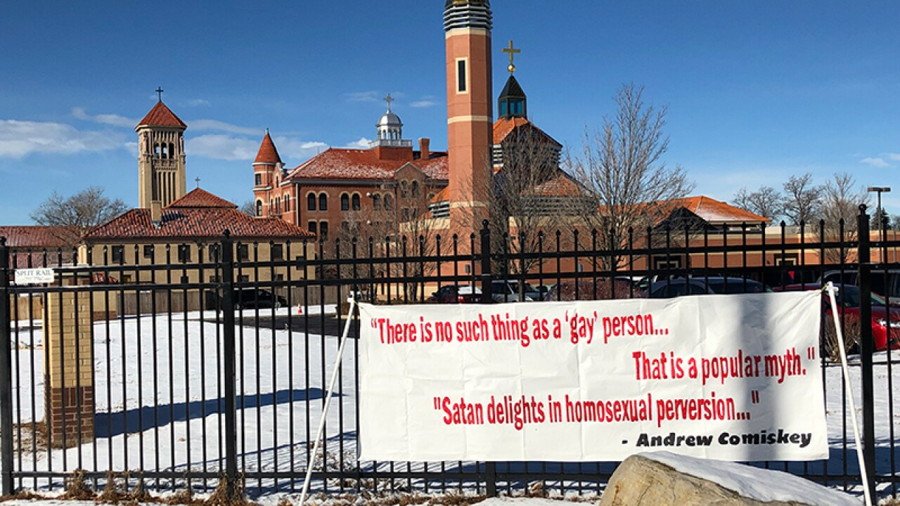 Outside group places banner on church property