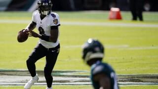 Ravens hold on for 30-28 win over depleted Eagles.jpg