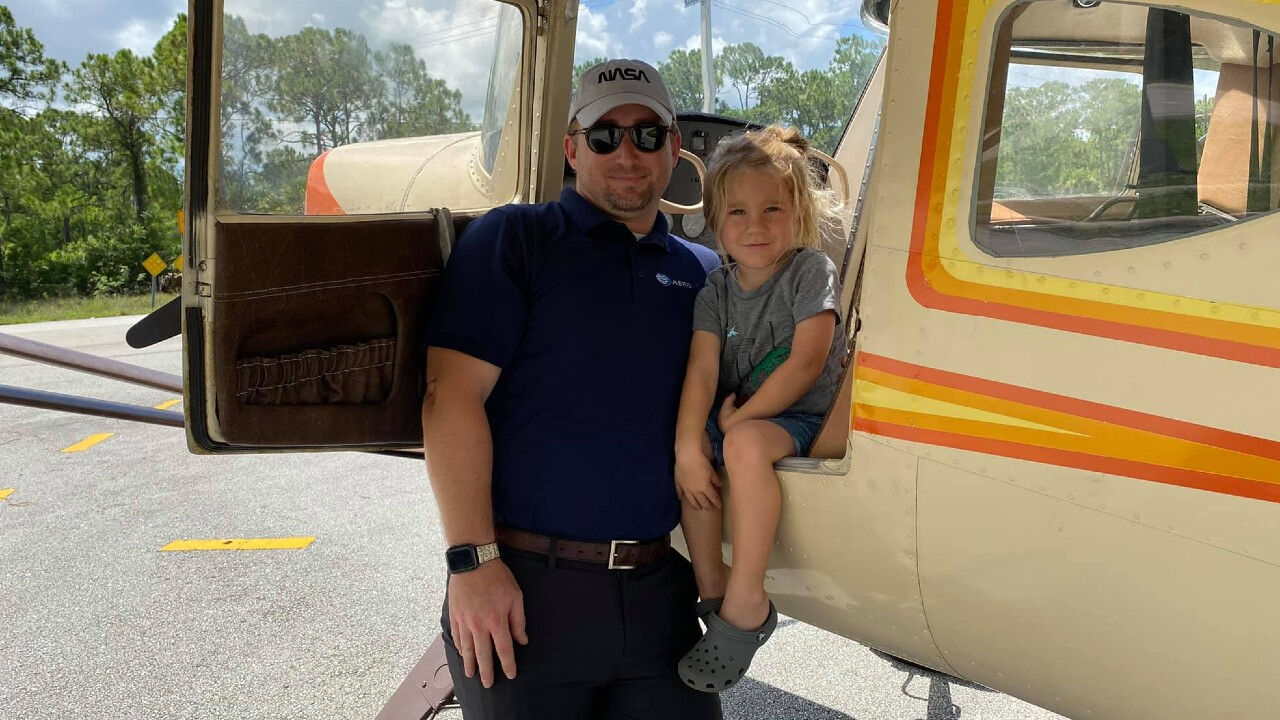 Pilot Adam Williams and his son, 4, following an emergency landing on Southwest Glades Cut-Off Road in Port St. Lucie on Aug. 2, 2021.jpg