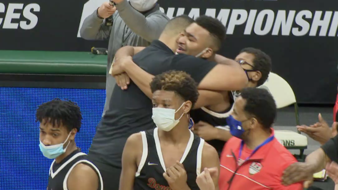 Pierre Brooks Sr and his son embrace after winning state championship