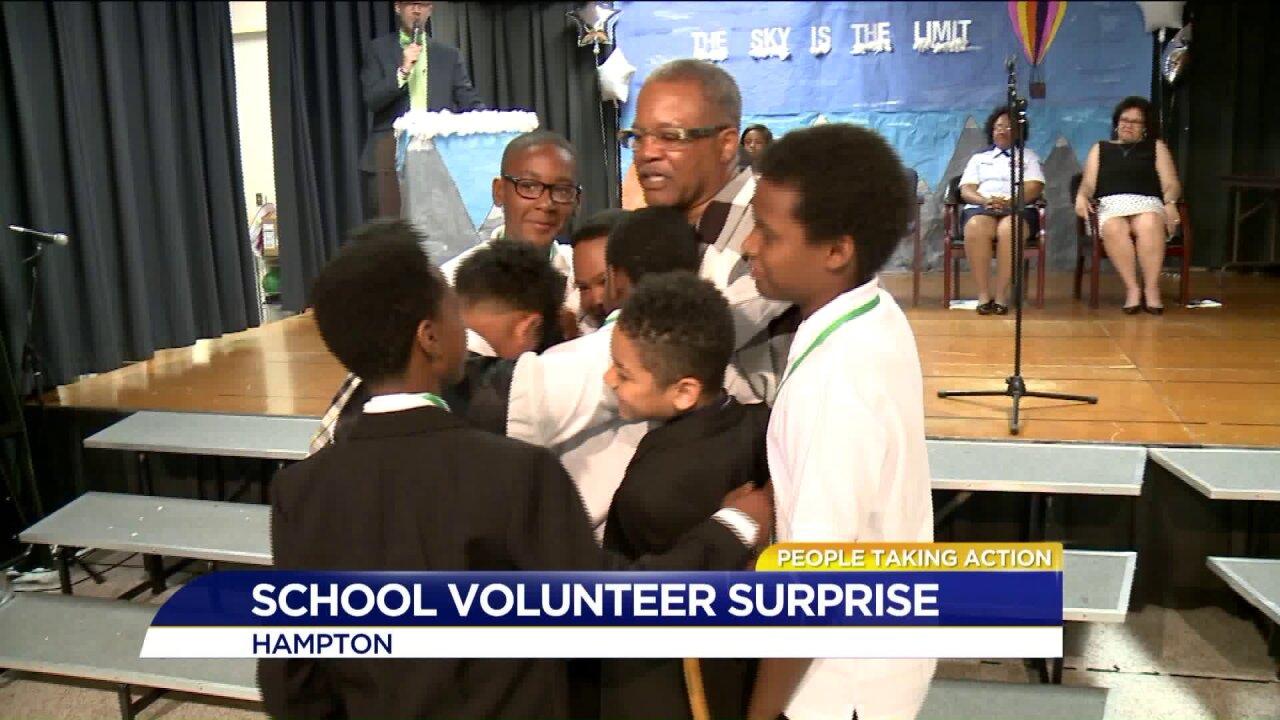 People Taking Action: volunteer surprised on last day ofschool!
