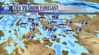 Slick roads and light snow for your Monday
