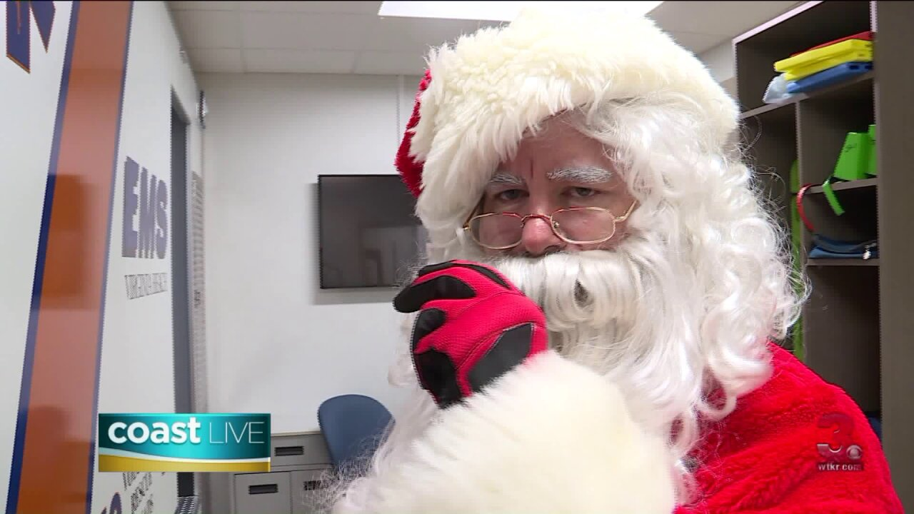Santa Claus steps away from assembling toys to comfort children during emergencies