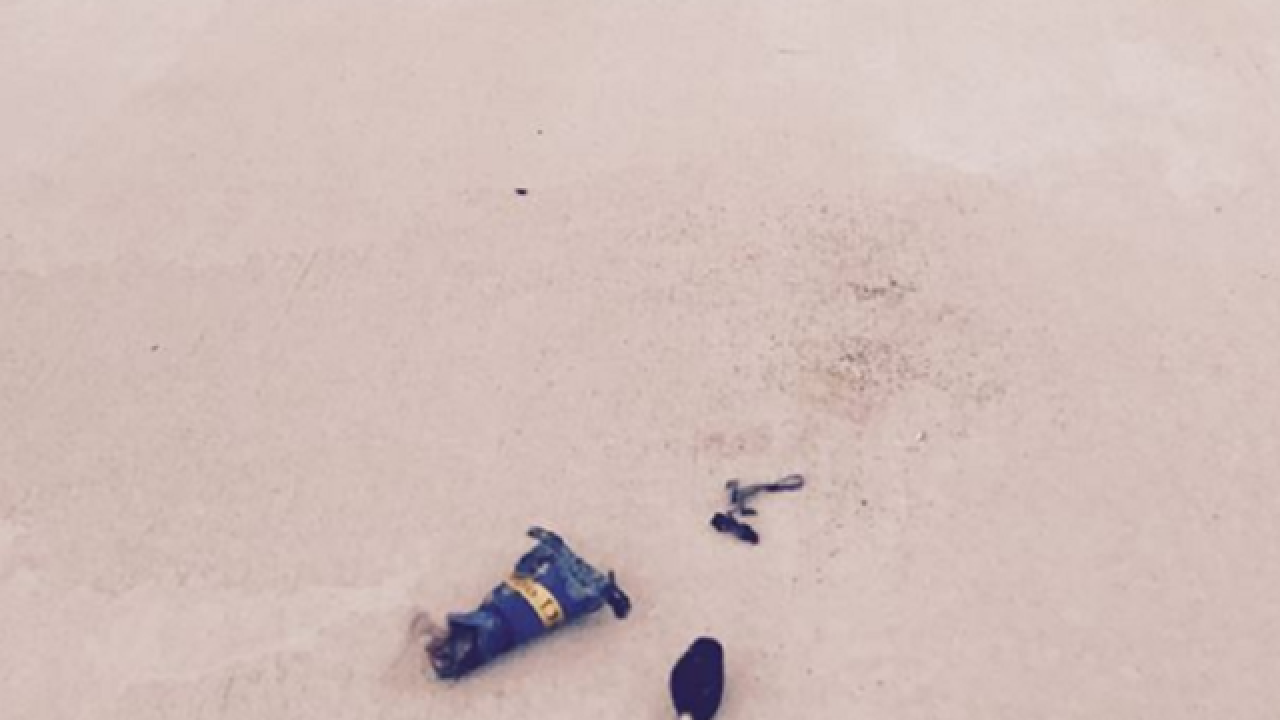 Beheaded Voodoo doll placed outside police station