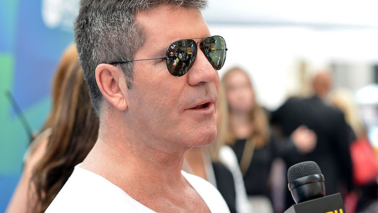 Simon Cowell treated in hospital after fainting, falling down stairs