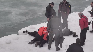 Video shows police rescuing man from icy Lake Michigan
