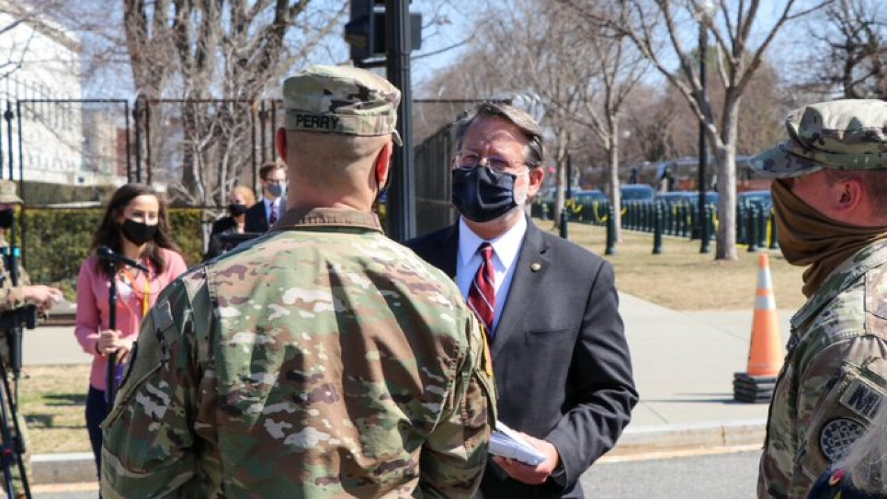 Senator Gary Peters with MI Natl Guard via Twitter.jpg