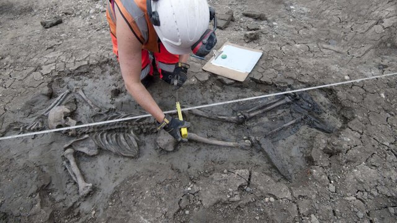 500-year-old skeleton w/thigh-high boots found