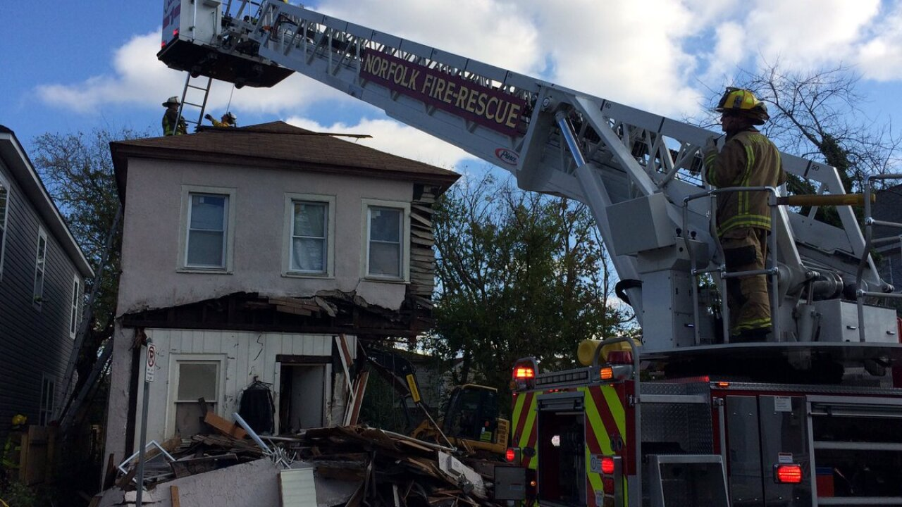 Crews rescue worker pinned during demolition of Norfolkhome