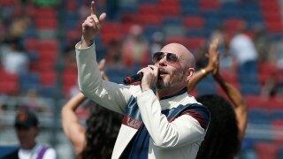 Pitbull sings at NASCAR race