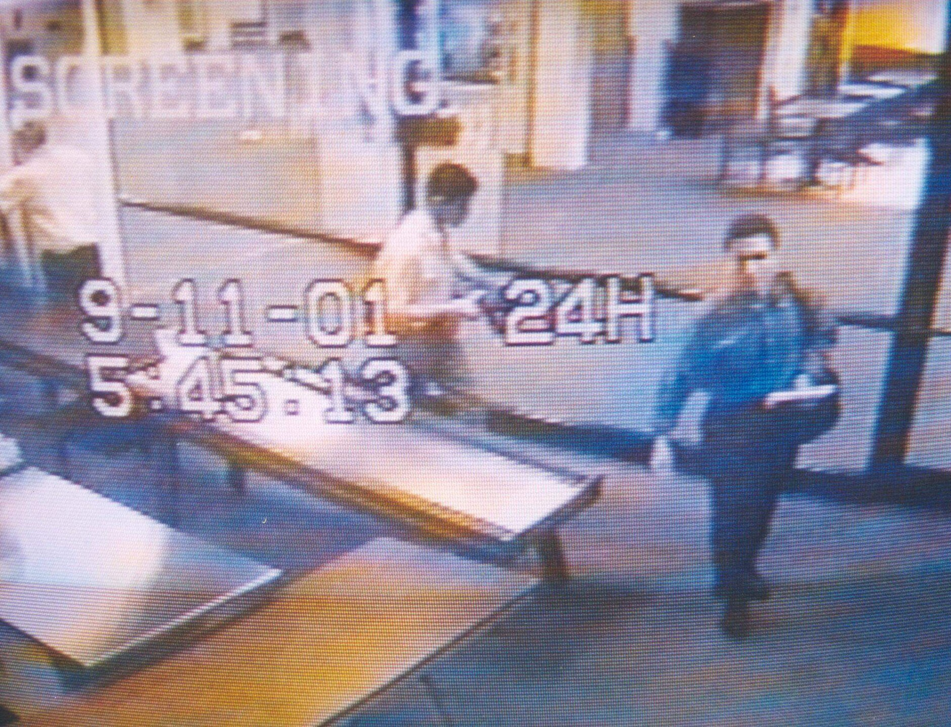 Surveillance Camera Photographs Two Men Identified By Authorities
