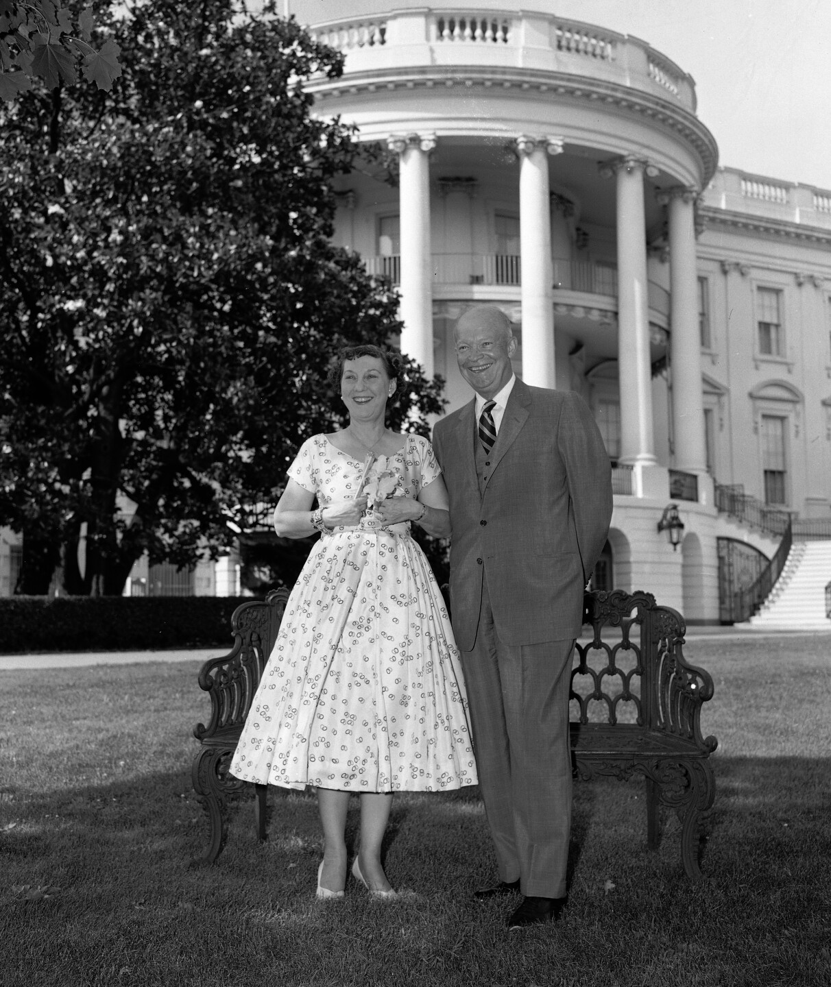 President Dwight D. Eisenhower and first lady Mamie Eisenhower pose for a 38th wedding anniversary photograph on the White House grounds, July 1, 1954. (AP Photo/William J. Smith)
