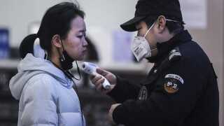 Public transportation suspended in Wuhan to help stop spread of coronavirus, reports say