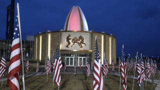 United States flags are displayed around the Pro Football Hall of Fame in Canton on Thursday, March 26. Photo by CantonRep.com/Scott Heckel.