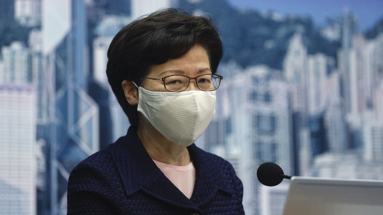 Hong Kong postpones elections by one year, citing coronavirus