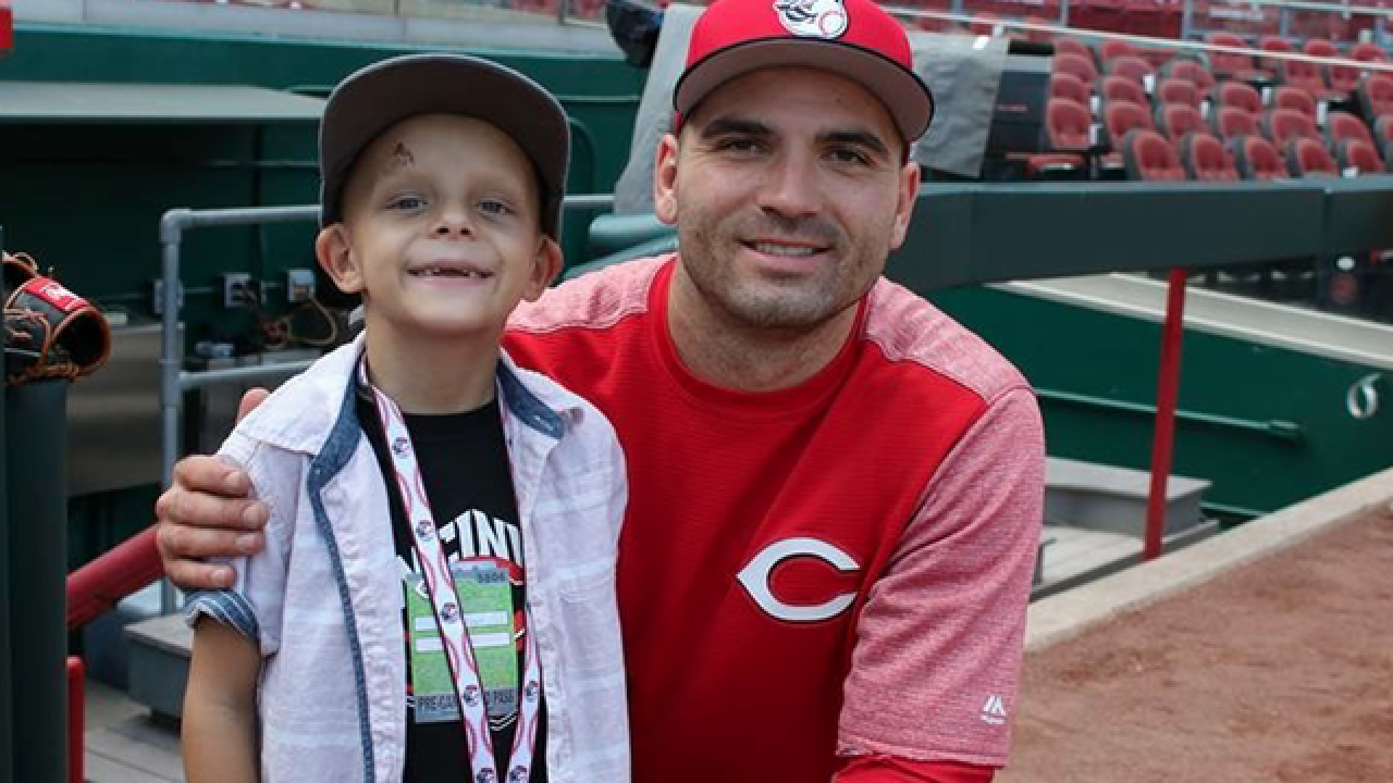 Votto gives HR bat to 6-yr-old fan with cancer