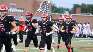 School district in Ohio bans 'thin blue line' flag after football player carried it onto field