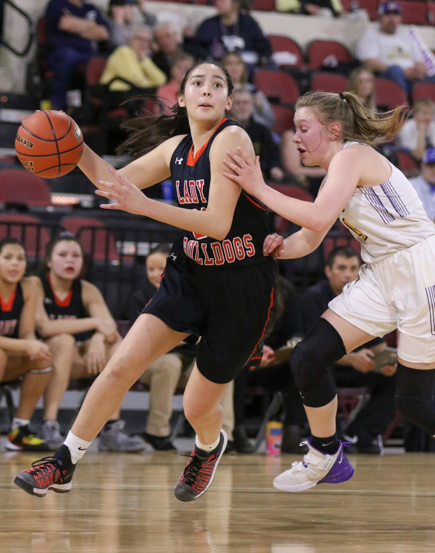 Gabby Lopez drives towards the hoop.jpg
