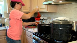 Michelle Weaver cans her homemade salsa