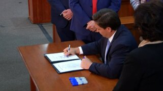 Gov. Ron DeSantis sign a COVID-liability bill into law in Tallahassee, Fla., on March 29, 2021, to protect businesses in Florida from lawsuits