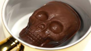 Skull-Shaped Hot Cocoa Bombs Are A Spooky-Sweet Halloween Treat
